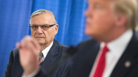 Sheriff Joe Arpaio (L) of Maricopa County, Arizona listens as Republican presidential candidate Donald Trump speaks to the press prior to a rally on January 26, 2016 in Marshalltown, Iowa.