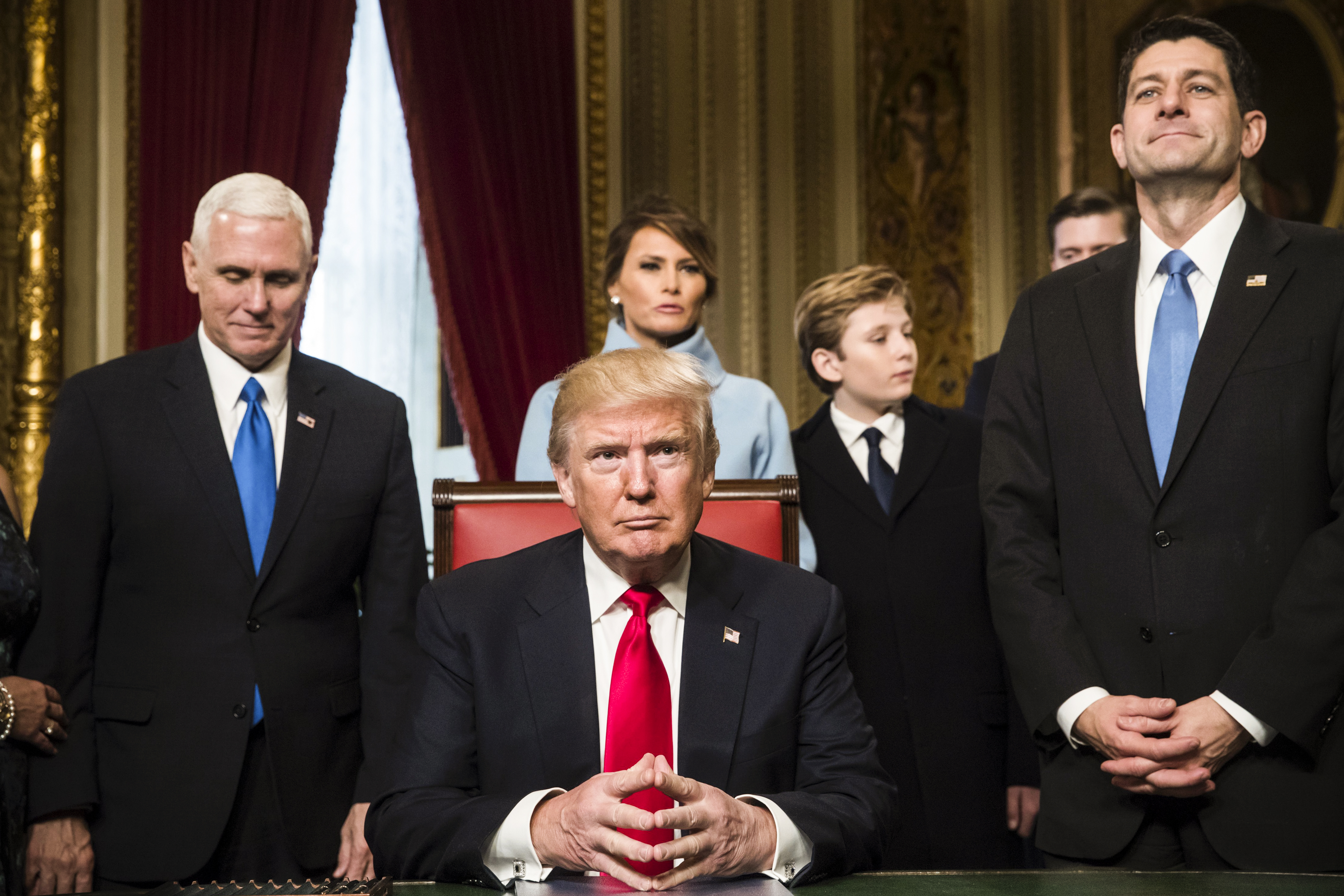 President Trump is assimilated by a Congressional caring and his family before rigourously signing his cupboard nominations into law on Jan 20, 2017.