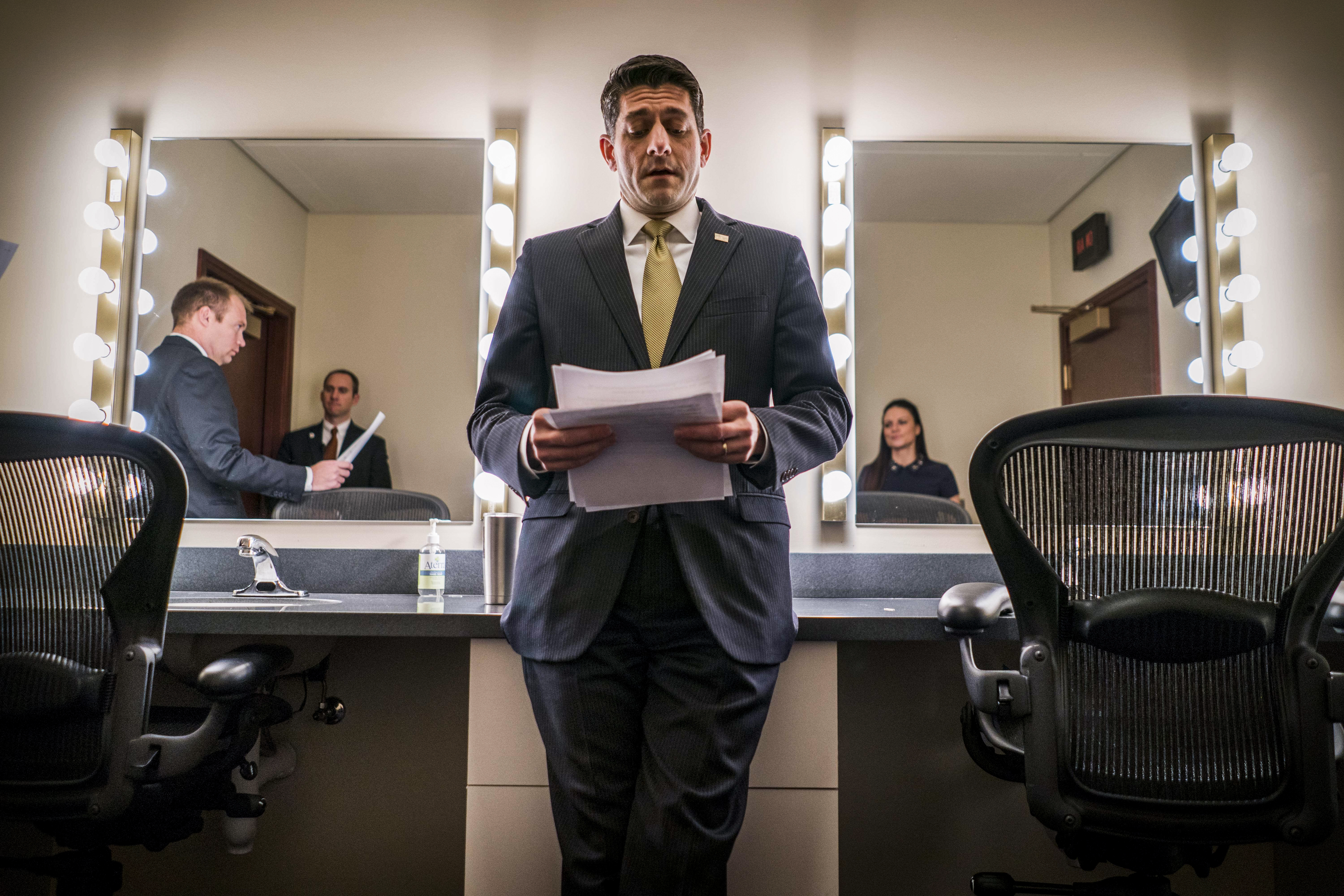 In a Ante Room, Paul Ryan prepares before his press discussion with a supervision shutdown appearing on Jan 18, 2018.