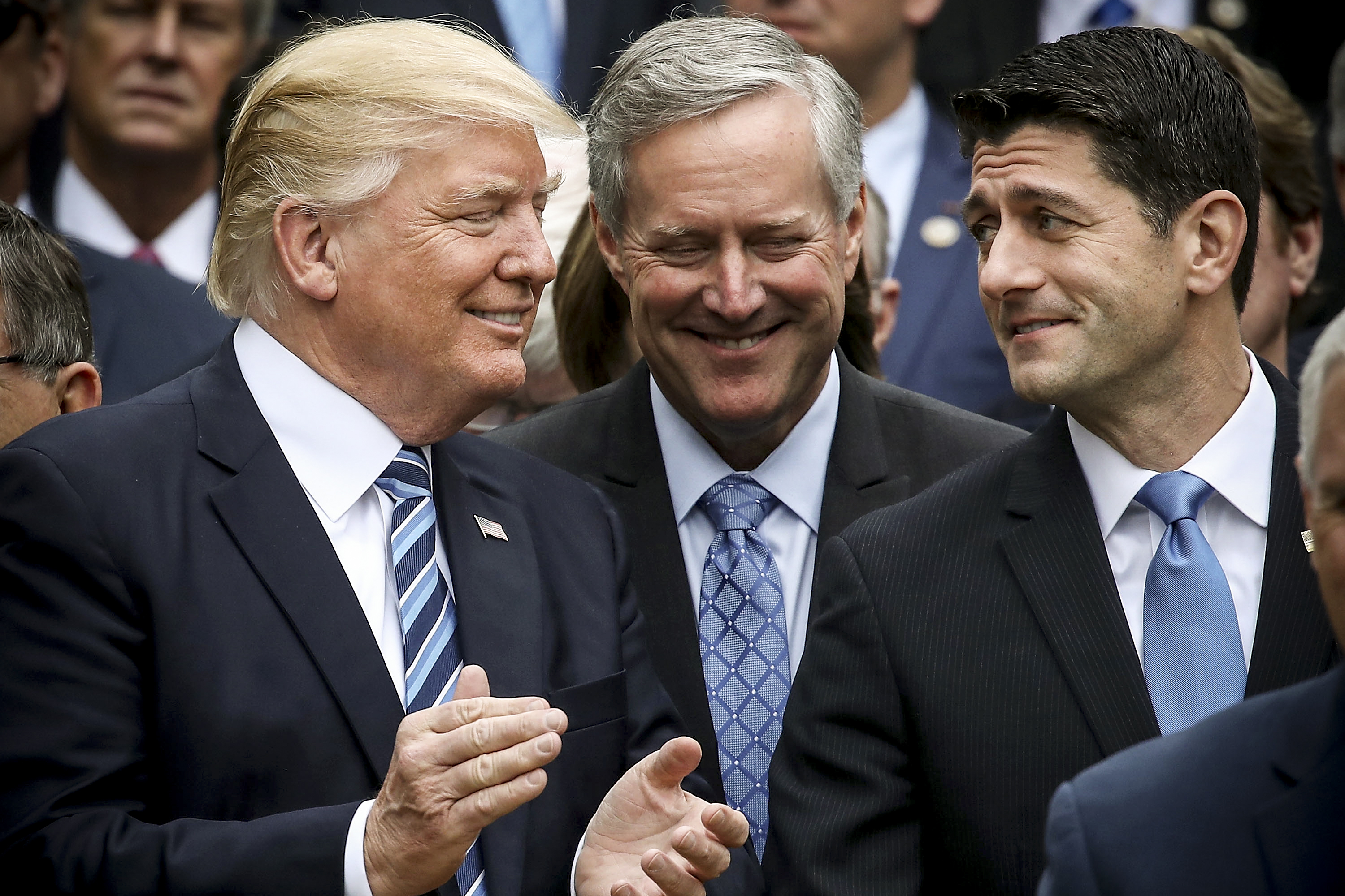 President Trump stands with Paul Ryan (R-WI) and Freedom Caucus Chairman Mark Meadows (R-NC), after Republicans upheld legislation directed during repealing and replacing ObamaCare on May 4, 2017.